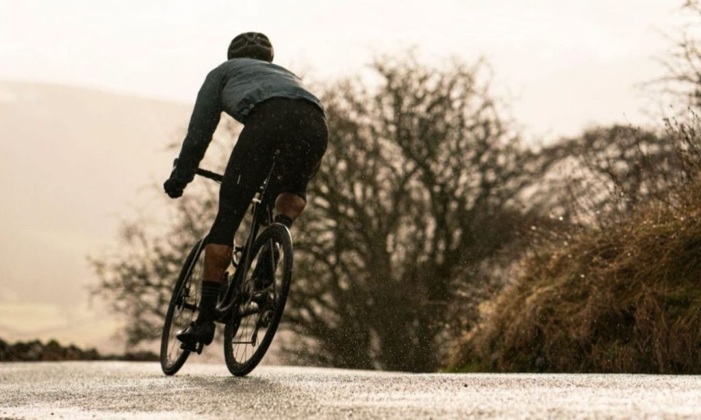 Man Cycling In Winter